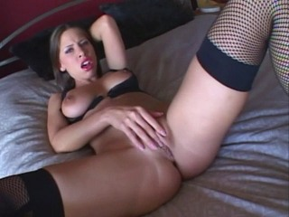 Very turned on brunette in black lingerie and fishnets plays with her panties and then her pussy